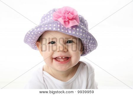 Happy baby wearing hat