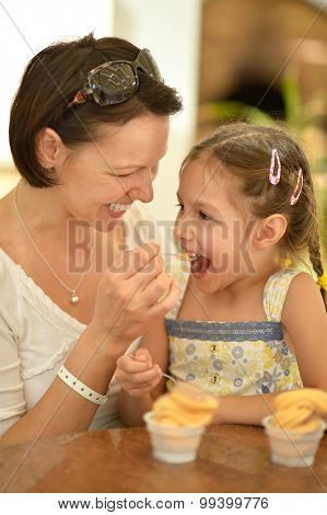 Little girl with mother eats