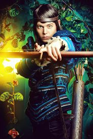 image of bow arrow  - Portrait of a male elf with a bow and arrows in a magical forest - JPG