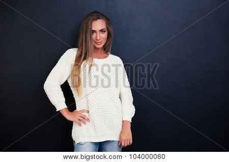 Portrait of a happy cute girl standing over gray background and looking at camera
