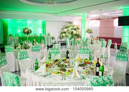 Wedding table with dishes and flowers
