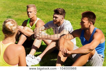 fitness, sport, friendship and healthy lifestyle concept - group of happy teenage friends or sportsmen outdoors