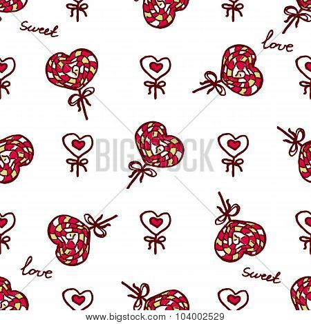 Seamless pattern with doodle heart shaped lollipops
