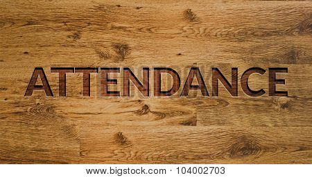 The word Attendance Engraved in Wooden Background