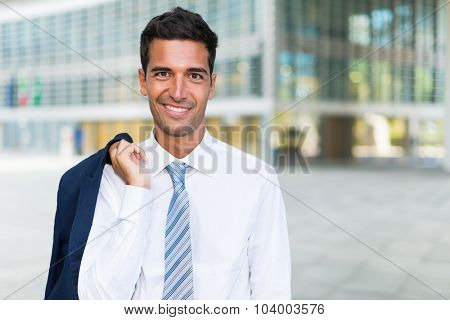 Portrait of a smiling businessman in an urban environment