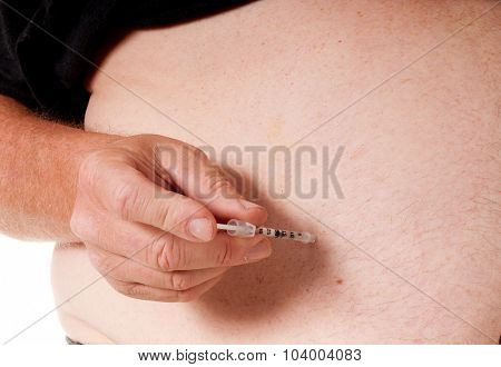 Diabetic injecting insulin into his stomach