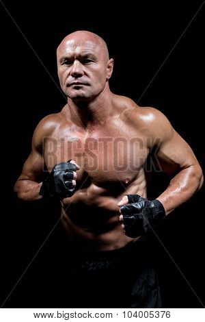 Portrait of confident man with fighter stance