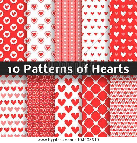 Heart shape vector seamless patterns. Red color.