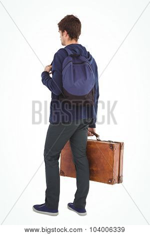Rear view of man with backpack and briefcase standing over white background