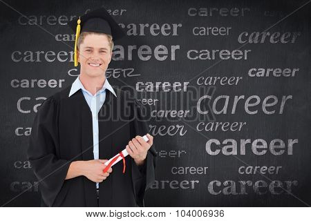Man smiling as he has just graduated with his degree against blackboard