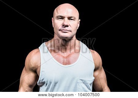 Portrait of confident man in vest against black background