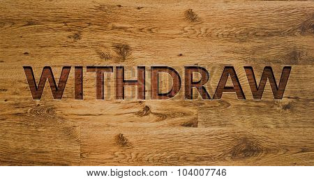 The word WITHDRAW Engraved in Wooden Background