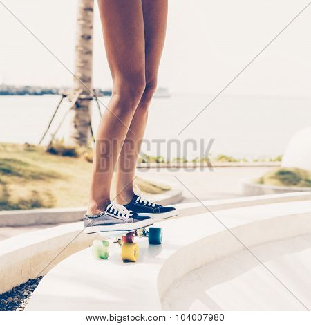 Sexy Suntanned Lady Is Ready To Go On Penny Board