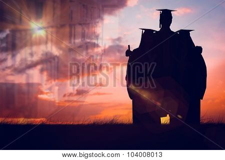 Full length of three friends graduate from college together against orange and blue sky with clouds