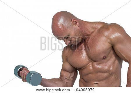 Shirtless athlete lifting dumbbells against white background