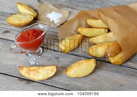 Baked Potatoes In A Paper Bag And Ketchup