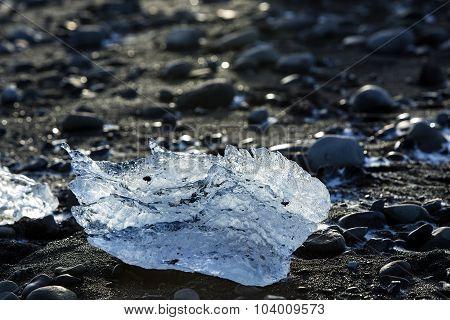 Ice Block On Black Sand Beach At Glacier Lagoon Jokulsarlon, Iceland