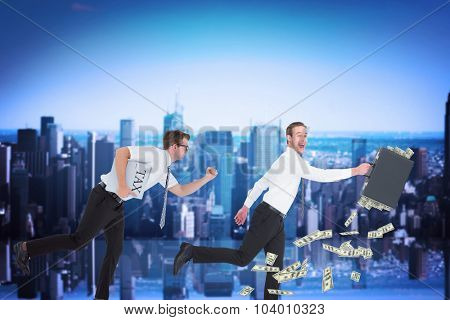 Running businessman against mirror image of city skyline