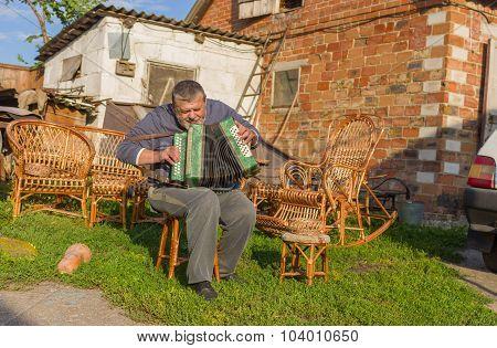 Ukrainian country-man playing button accordion