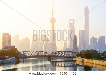 landmarks and a bridge of shanghai on the shore