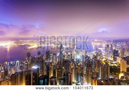 panorama of skyscrapers and a river around the city at night