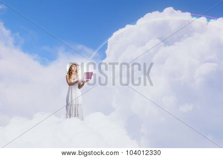 Young lady standing on cloud and using laptop