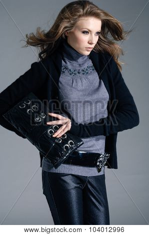 fashion model holding little purse posing