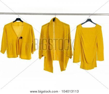 Set of female yellow dress isolated on hanging