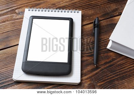 Notebook, E-reader/tablet, Book On Old Wood Table