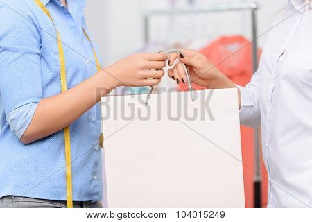 Professional designer talking with her client