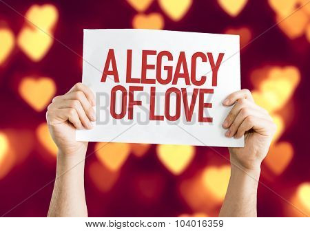 A Legacy of Love placard with heart bokeh background