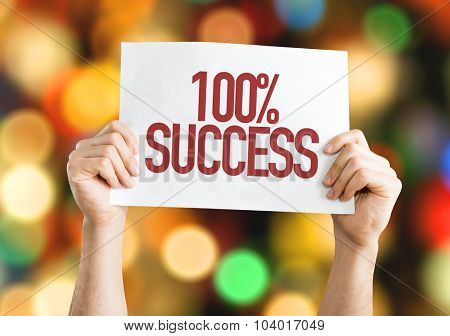 100% Success placard with bokeh background