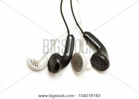 Black And White Earbuds Isolated On White