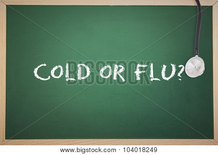 The word cold or flu? and stethoscope against chalkboard