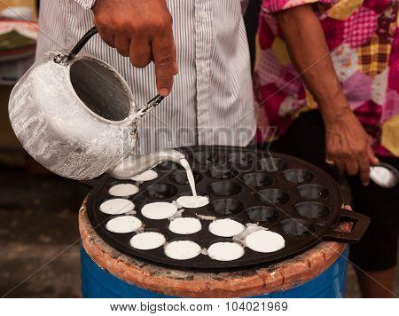 A Man Is Cooking Kanom Krok , Dessert Thai Sweet.