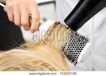 Drying hair on a round brush