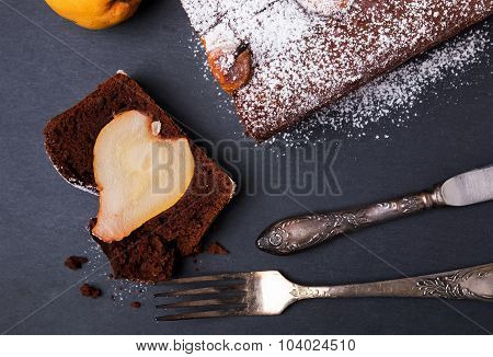 A Piece Of Delicious Chocolate Cake With Pears