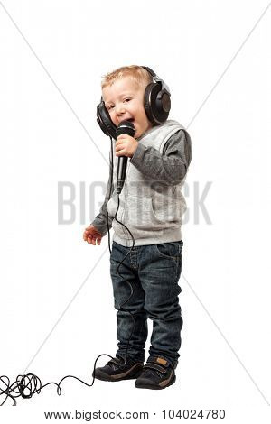 little child with headphone sing a song