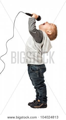 child sing and enjoy with microphone isolate don white background