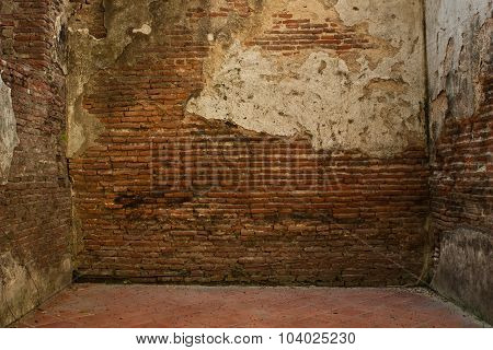 A Room With An Old Red Brick Walls And Disrepair.