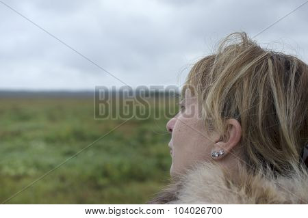 Woman Looking To Horizon