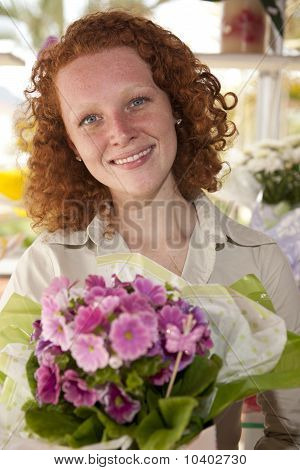 Flower Gift: Woman Giving A Bunch Of Flowers