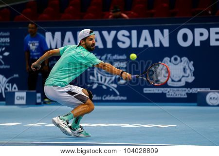 KUALA LUMPUR, MALAYSIA - SEPTEMBER 27, 2015: Philipp Petzschner of Germany plays in his qualifying match at the Malaysian Open 2015 Tennis tournament held at the Putra Stadium, Malaysia.