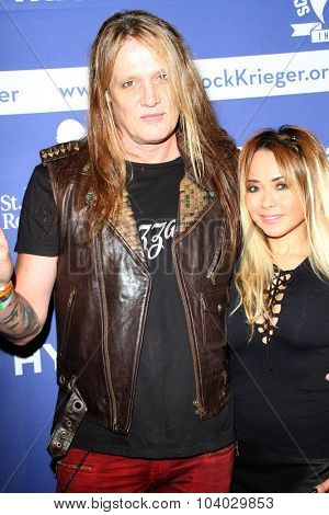 MOORPARK, CA - OCT 5: Sebastian Bach and wife arrive at the 8th Annual Medlock/Krieger Invitational Golf Concert at the Moorpark Country Club in Moorepark, CA on October 5, 2015.