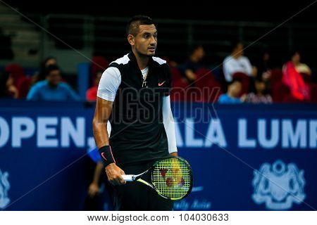 KUALA LUMPUR, MALAYSIA - SEPTEMBER 30, 2015: Nick Kyrgios of Australia reacts after a play in his match at the Malaysian Open 2015 Tennis tournament held at the Putra Stadium, Malaysia.