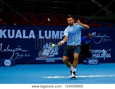 KUALA LUMPUR, MALAYSIA - SEPTEMBER 30, 2015: Michal Przysiezny of Poland hits a forehand return in his match at the Malaysian Open 2015 Tennis tournament held at the Putra Stadium, Malaysia.