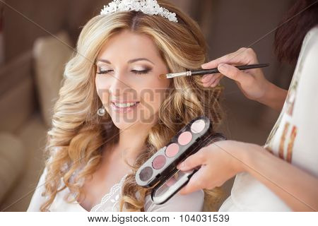 Beautiful Smiling Bride Wedding Portrait With Makeup And Hairstyle. Stylist Makes Make-up Girl On We