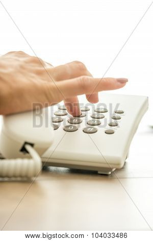 Closeup Of Female Hand Dialing A Telephone Number To Make  A Personal Call