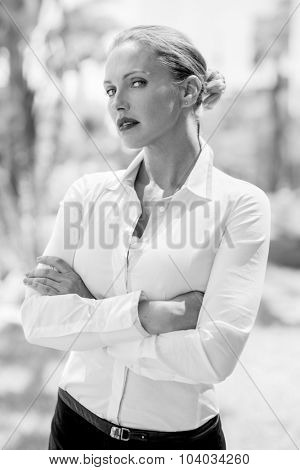 Elegant Serious Business Woman Posing With Arms Folded on Black and White Photo
