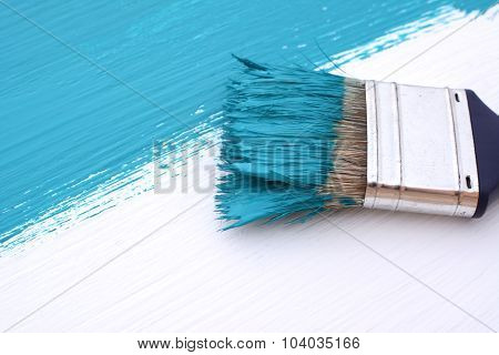 Close-up Of Paintbrush Painting A White Board Blue